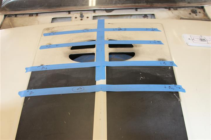 Tape was laid out on the center line of the hood and other tape perpendicular to it running out to each of the holes.