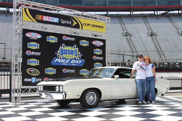 "Katrina and me in Winner's Circle at Bristol Motor Speedway after completing out ""Hot Laps"" in our Talladega!"