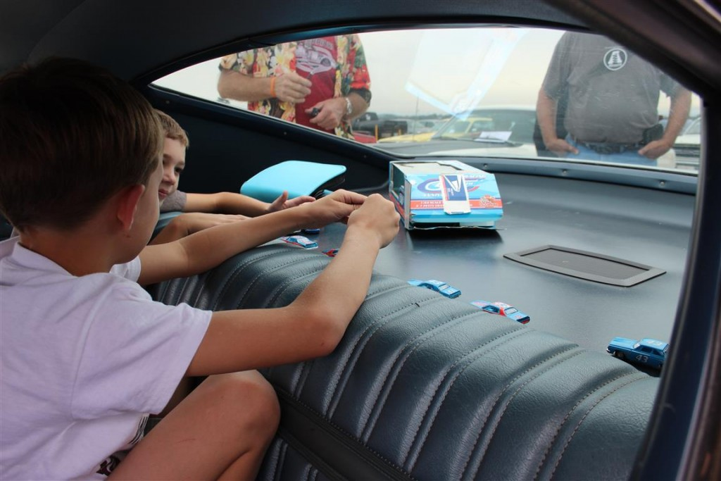 This was a trip for the entire family. These are Mike Atkin's grandkids playing in the back seat of his Talladega just prior to doing the Parade Lap at Talladega!