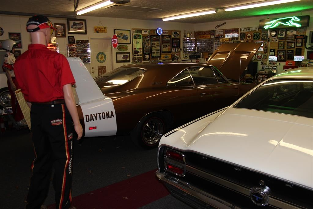 The Aero Wars are also fought in other ways in our Cave. The mannequin in the left side of this image is an autographed Mopar Buddy Baker uniform