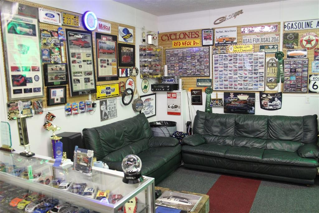 This corner of our Man Cave gets the most use. From the couch we can view the TV, reach the refrigeratior and see all the cars. There is no shortage of conversation with all the stimulation within view.