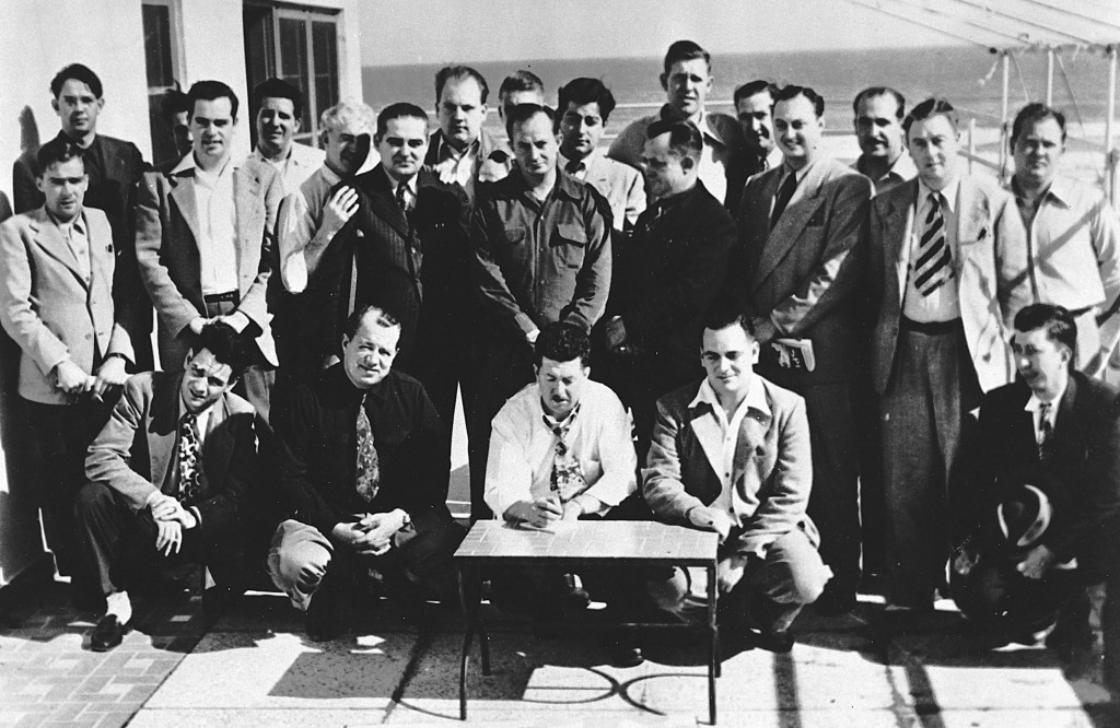 DAYTONA BEACH, FL - DECEMBER 14, 1947: A series of three meetings convened at the Streamline Hotel to establish criteria for professional stock car racing, leading to the formation of NASCAR. In this group: Front row, kneeling (L-R) - Chick DiNatale, Jimmy Quisenberry, Ed Bruce, Jack Peters, Alvin Hawkins. Back row, standing (L-R) - Freddie Horton, Sam Packard, Ed Samples (hidden), Joe Ross, Marshall Teague, Bill Tuthill, Joe Littlejohn, Bob Osiecki, Buddy Shuman,, Lucky Sauer (hidden), Tom Galan, Eddie Bland, Bill France Sr., Bob Richards, Harvey Tattersall Jr., Fred Dagavar, Bill Streeter, Jimmy Cox. (Photo by ISC Archives via Getty Images)
