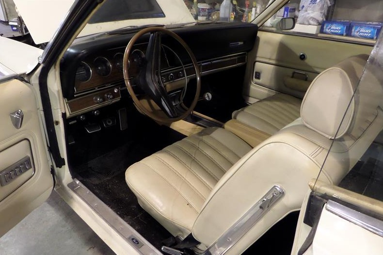 I love the idea of a white bucket seat interior and check out all those PW buttons on the driver's door panel! Also, note the lack of red paint on the quarter panel next to the door opening. On the production cars the red roof and trunk paint also comes up the top of the quarter panel to the door opening.