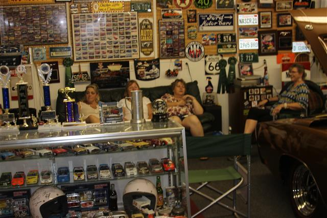 It was a very hot day and the air conditioned garage was a favorite spot to talk cars and stay comfortable.