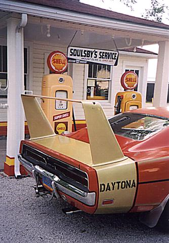 I know it is a Daytona but a Spoiler II parked in front of this old station would sure look good.