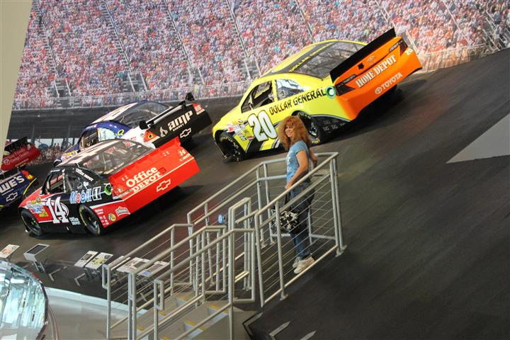 Katrina stands on the stairs leading to the Talladega 33-degree banking.